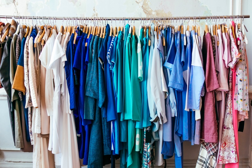 Colorful women's dresses on hangers