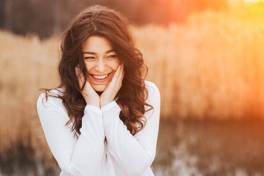 beautiful smile hides her blushing