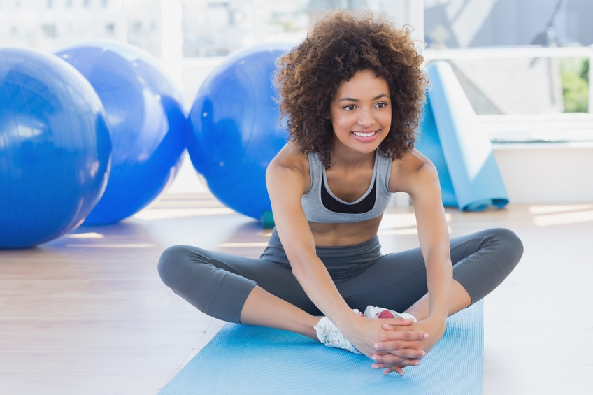 fit young woman doing the butterfly stretch