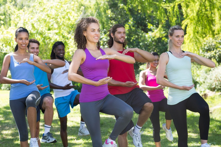 Fitness group doing tai chi