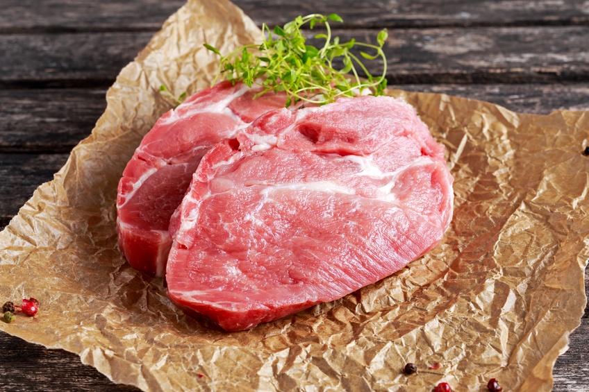Raw pork shoulder on butcher paper