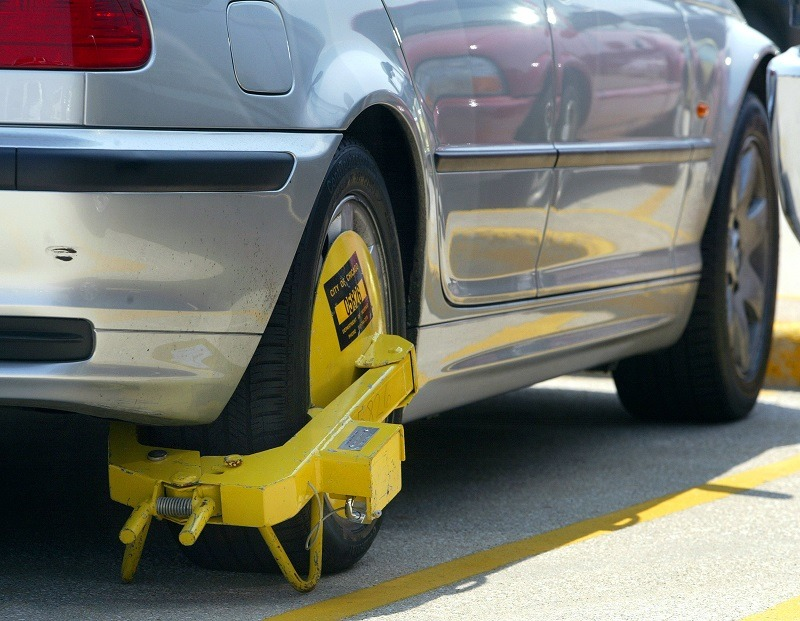 A parking boot, placed by enforcement officers