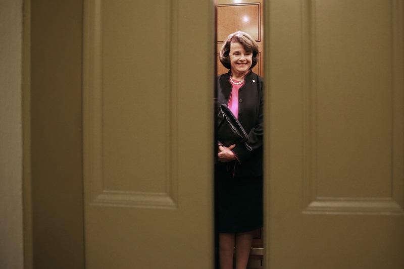 Dianne Feinstein takes an elevator