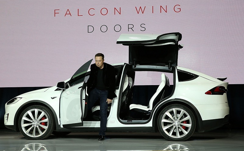 FREMONT, CA - SEPTEMBER 29: Tesla CEO Elon Musk demonstrates the falcon wing doors on the new Tesla Model X Crossover SUV during a launch event on September 29, 2015 in Fremont, California. After several production delays, Elon Musk officially launched the much anticipated Tesla Model X Crossover SUV.