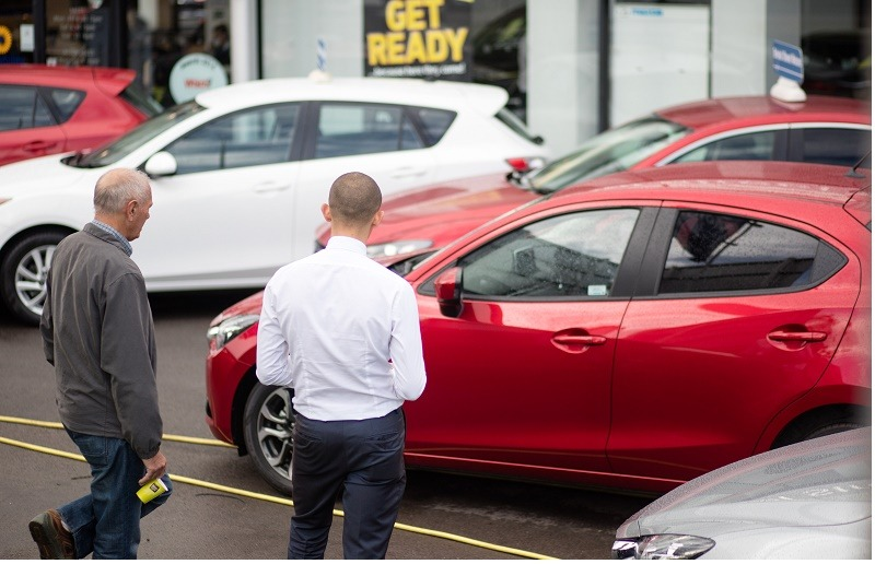 BRISTOL, ENGLAND - OCTOBER 06: A customer looks at a brand new Mazda car that is offered for sale on the forecourt of a main motor car dealer in Brislington on October 6, 2015 in Bristol, England. Latest data from the Society of Motor Manufacturers and Traders (SMMT) show a record 462,517 new cars were registered in the UK last month, a 8.6% year on year increase, and that total sales in the year to date have hit 2,096,886, 7.1 percent higher than the same point last year and the first time the two million mark has been passed in September since 2004.