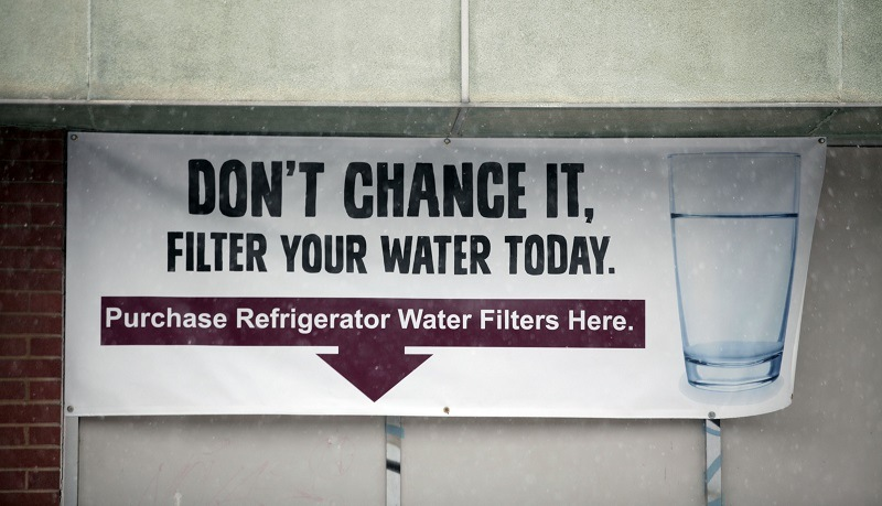 A sign on the front of a building warns residents to filter their drinking water in Flint, Michigan