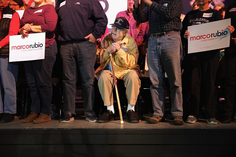A senior citizens listen to Republican Sen. Marco Rubio at a rally