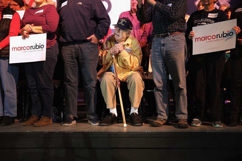 A senior citizens listen to Republican Sen. Marco Rubio at a rally