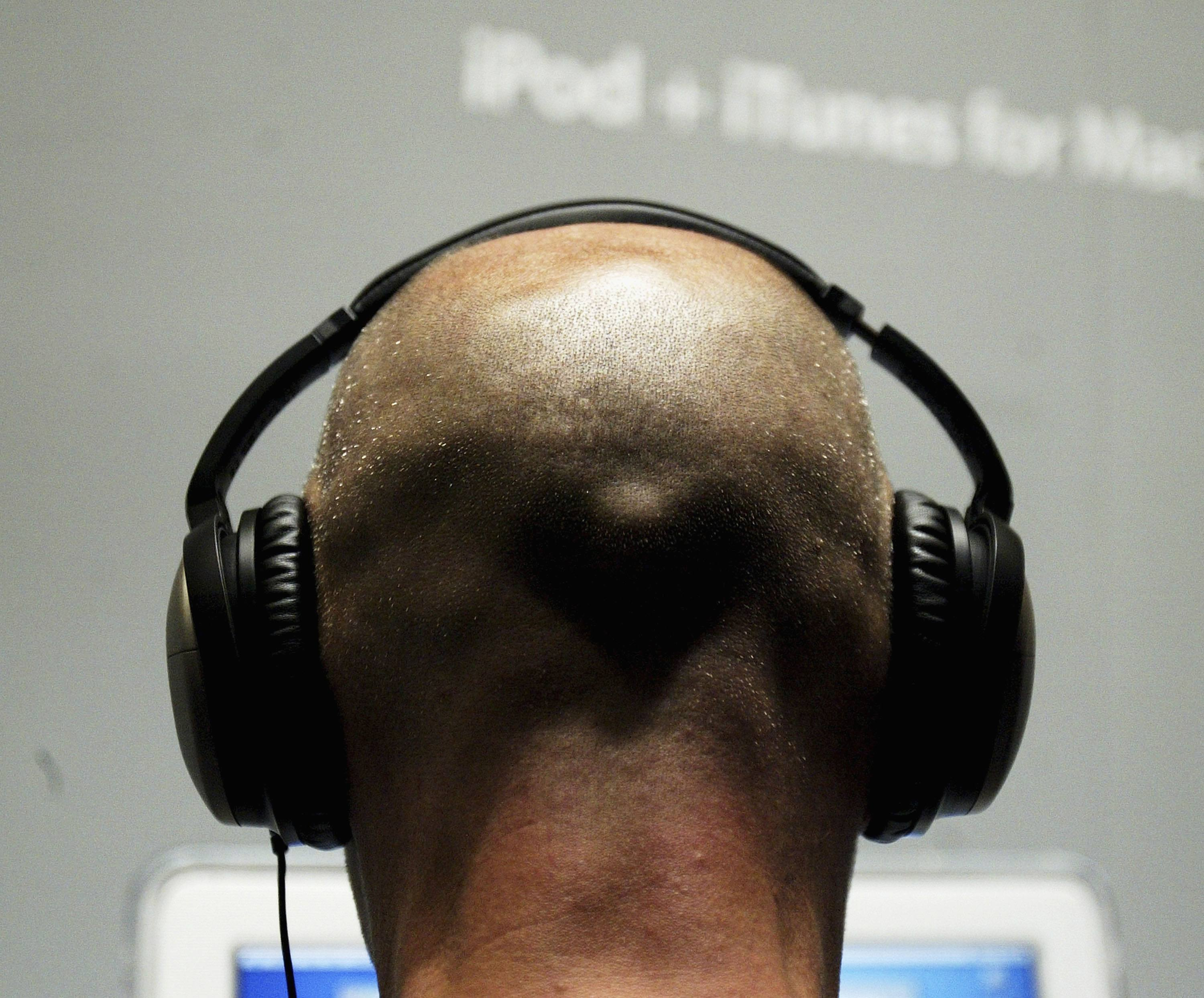 A man listens to music with headphones