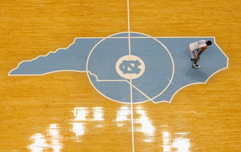 The North Carolina state profile on the floor of the UNC basketball arena