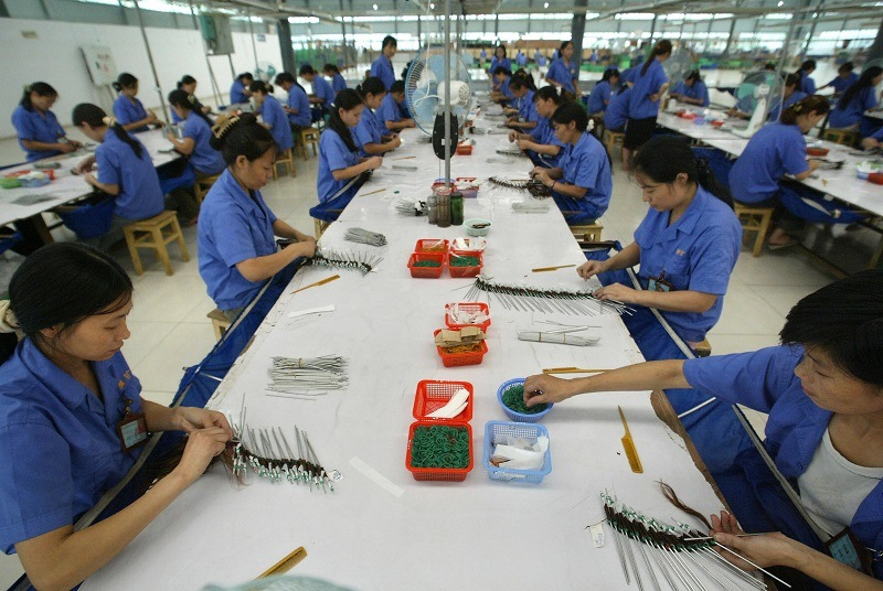 Workers assemble goods at a Hong Kong-China joint-venture factory