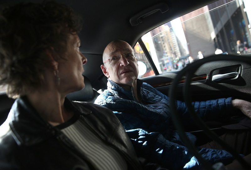 A cancer patient rides to a doctor's appointment with his wife