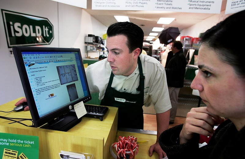 A store's manager works with an employee