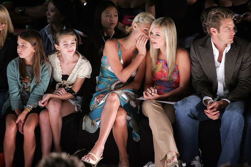Socialite Paris Hilton, who managed to get rich and attain great wealth with little effort, sits in the front row at a fashion show