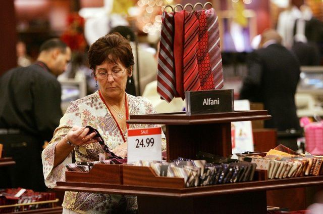 Woman browsing ties in a department store