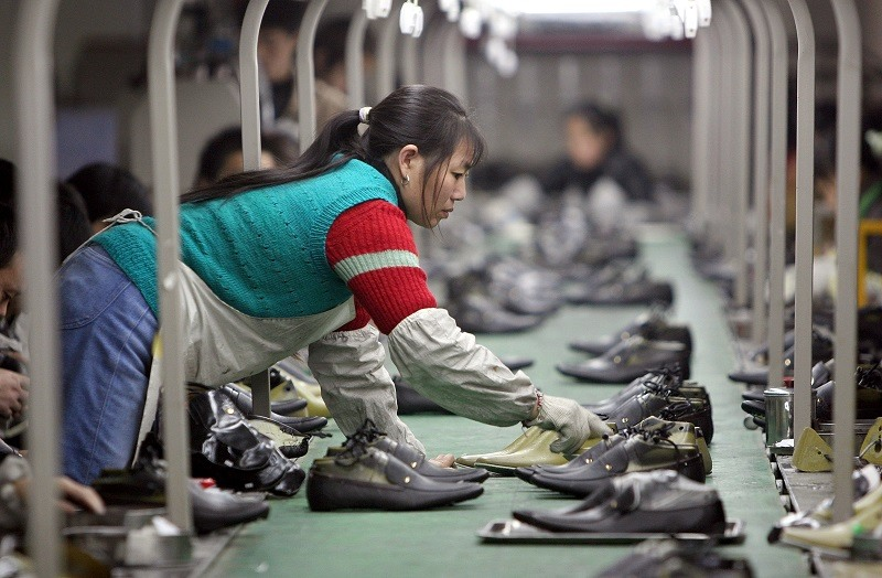A Chinese worker in a shoe factory