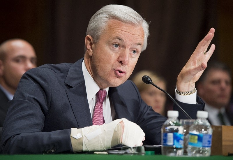 John Stumpf, chairman and CEO of Wells Fargo, testifies about the unauthorized opening of accounts by Wells Fargo during a Senate Banking, Housing and Urban Affairs Committee hearing on Capitol Hill in Washington, DC, September 20, 2016. / AFP / SAUL LOEB (Photo credit should read SAUL LOEB/AFP/Getty Images)