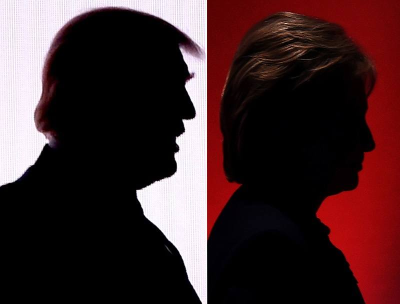 The silhouettes of then-Republican presidential nominees Donald Trump and then-Democratic presidential nominee Hillary Clinton