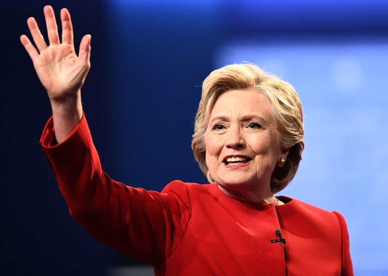 Democratic nominee Hillary Clinton waves after the first presidential debate at Hofstra University