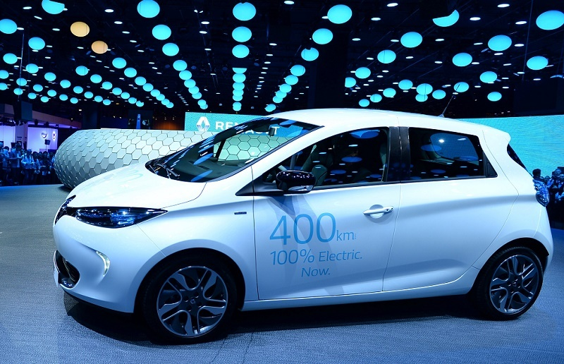 French carmaker Renault CEO Carlos Ghosn talks in front of an electric car Zoe at press days of the Paris motor Show on September 29, 2016.