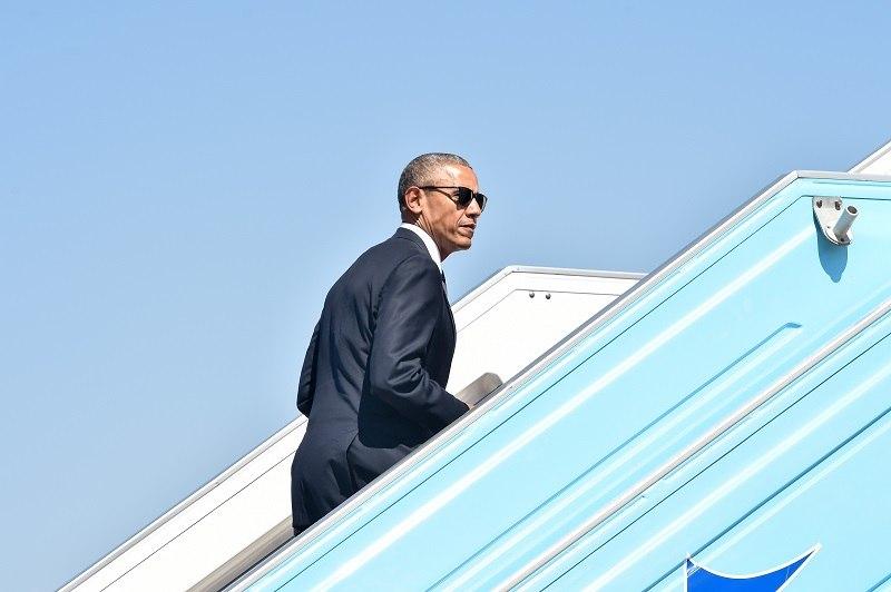 US President Barack Obama boards Air Force One