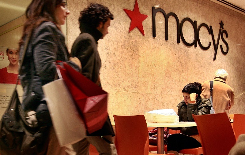 Customers leave a Macy's store