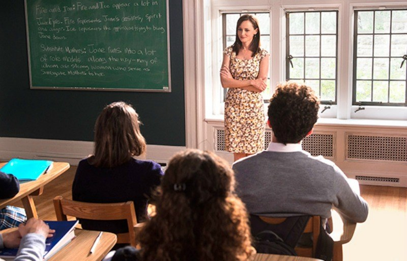 Young Woman in a classroom talking to students in Gilmore Girls: A Year in the Life