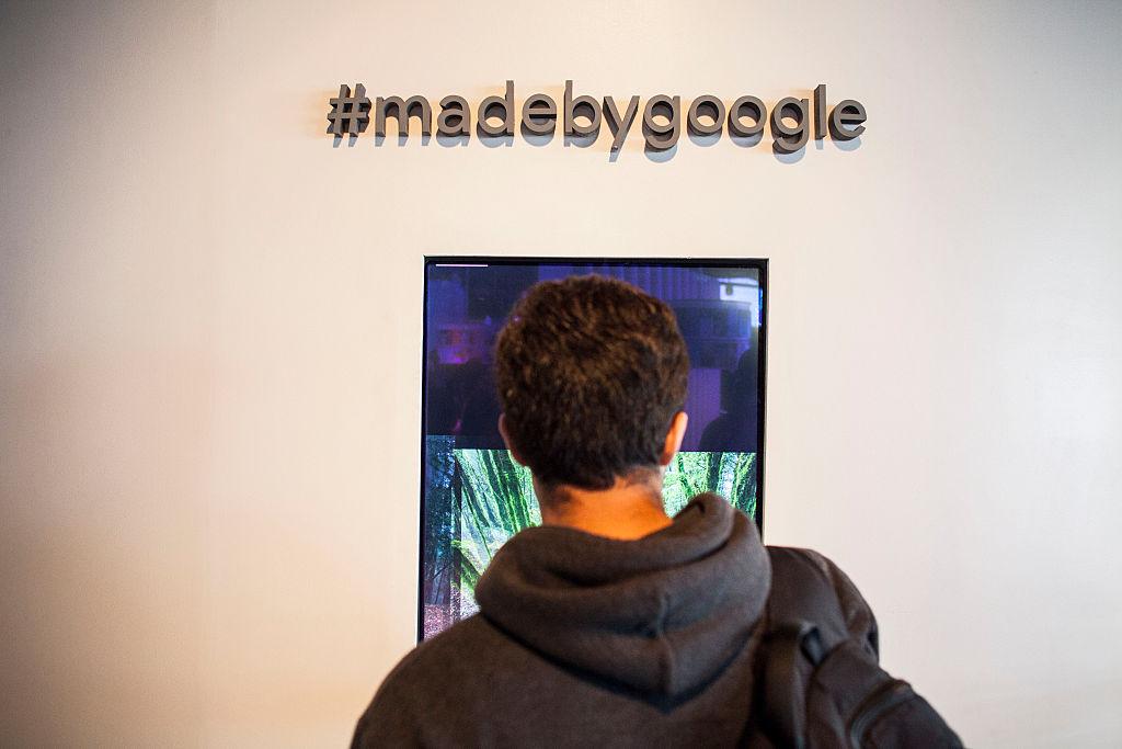 Members of the media examine Google's Pixel phone