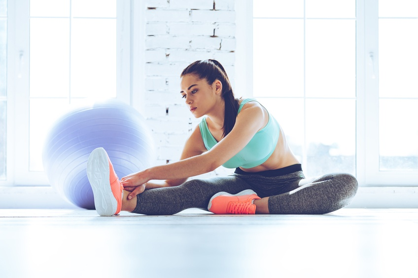 woman in sportswear doing stretching