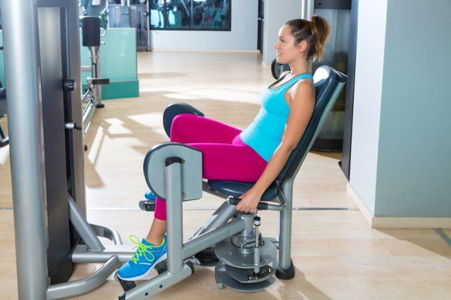 Hip abduction woman exercise at gym