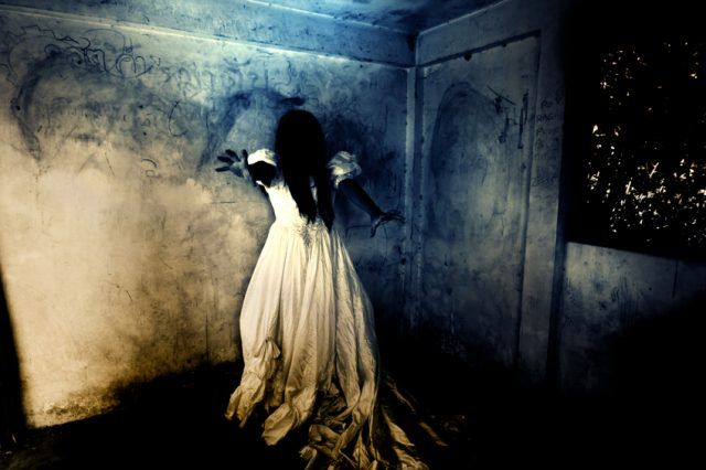 Mysterious Woman in White Dress Standing in Abandon Building