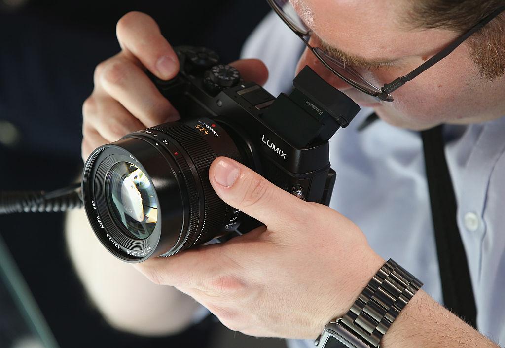 A visitor tries out the Lumix DMC-GX8 digital camera