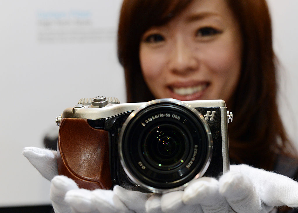 A model poses with Hasselblad's Lunar digital camera digital camera
