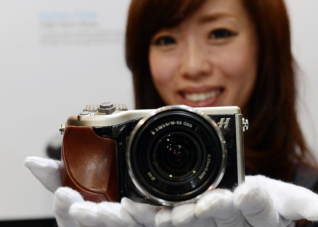 A model poses with Hasselblad's Lunar digital camera digital camera