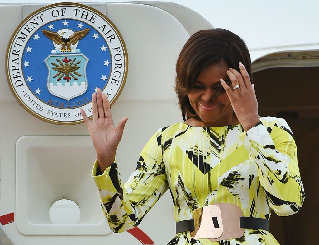 US First Lady Michelle Obama waves upon her arrival at Haneda International Airport in Tokyo