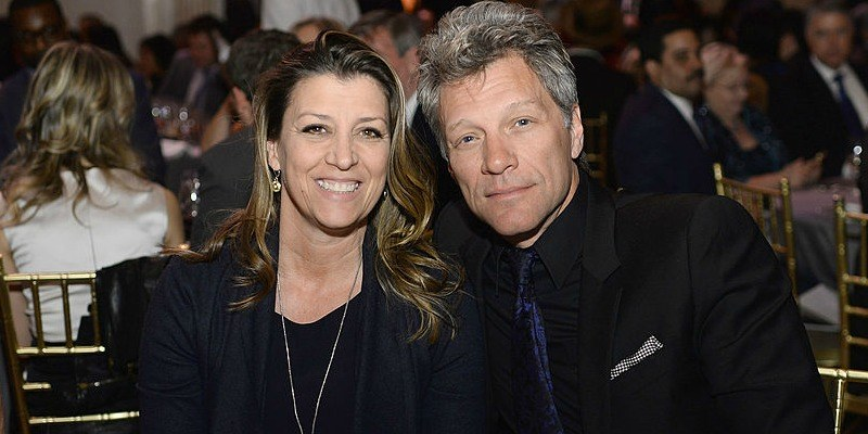 Jon Bon Jovi poses with Dorothea as they are sitting down next to each other.