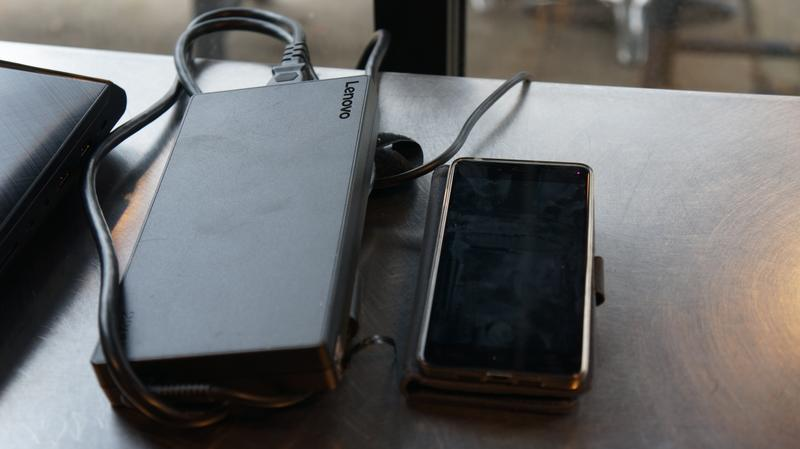 Ideapad Y900 power brick next to a phone