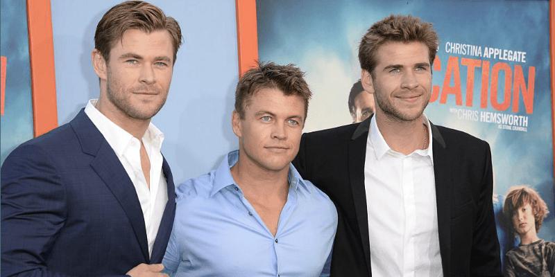 Liam, Luke, and Chris Hemsworth at a movie premiere