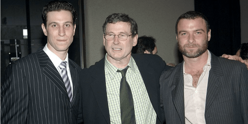 Liev and Pablo Schreiber pose with their father in suits.