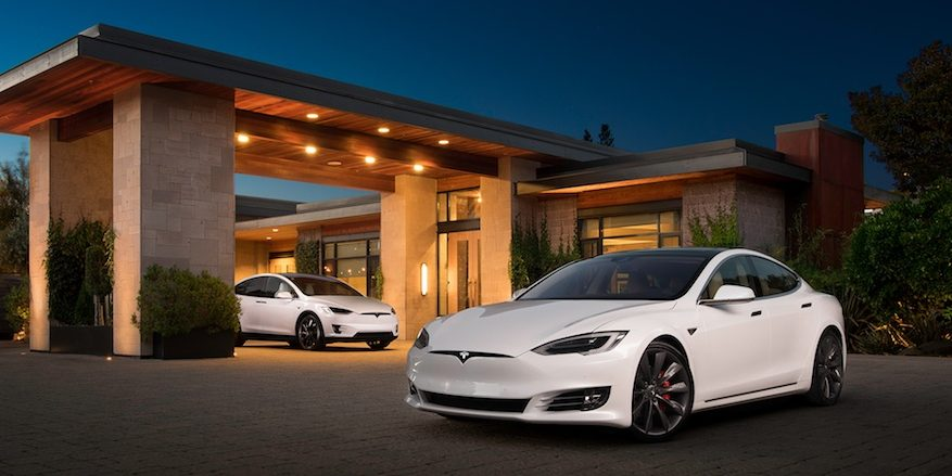 White 2016 Tesla Model S with 2016 Model X in background