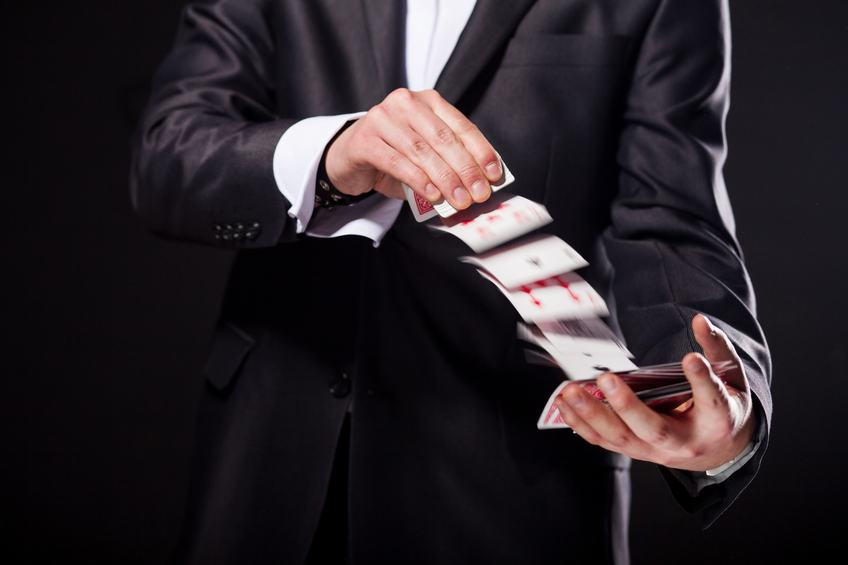 magician showing tricks using cards