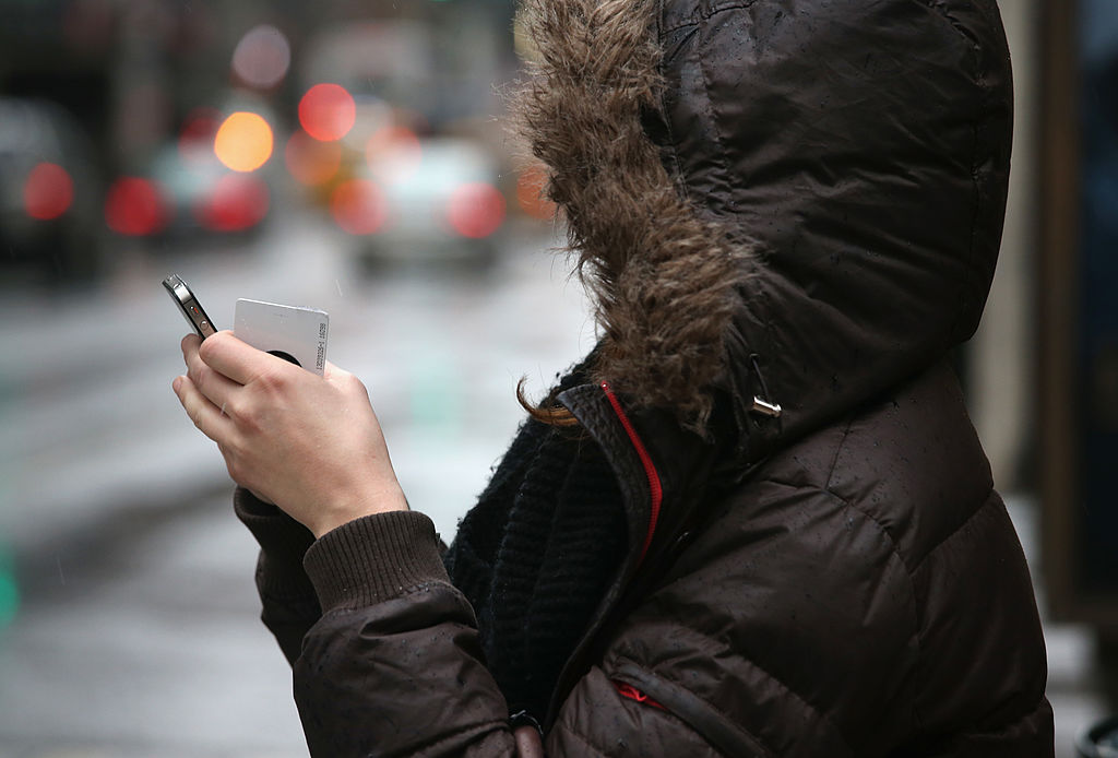 A woman checks her smart phone