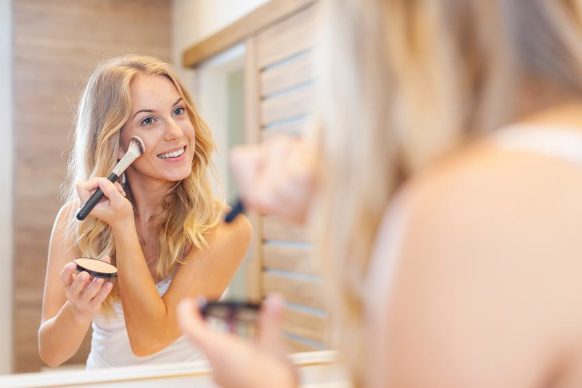 beautiful woman doing her makeup