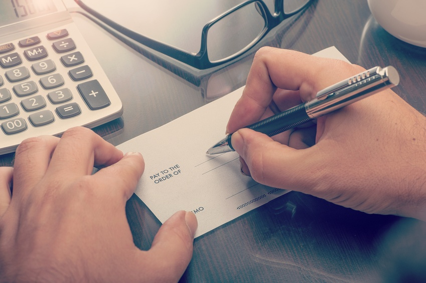 Man writing a payment cheque