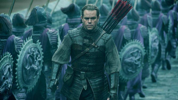Matt Damon walking toward the camera on a battlefield