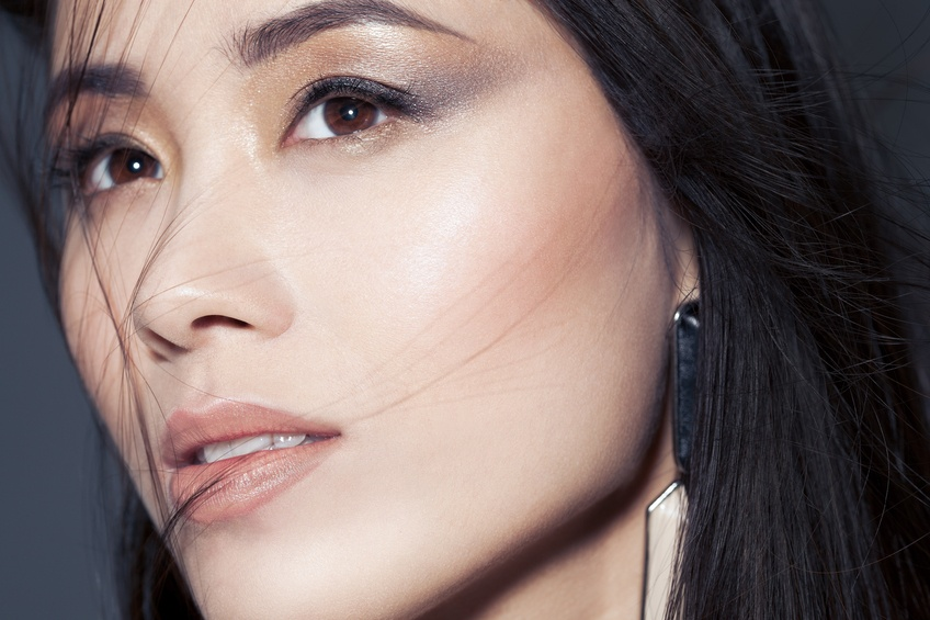 beautiful Asian woman with metallic smoky eyeshadow