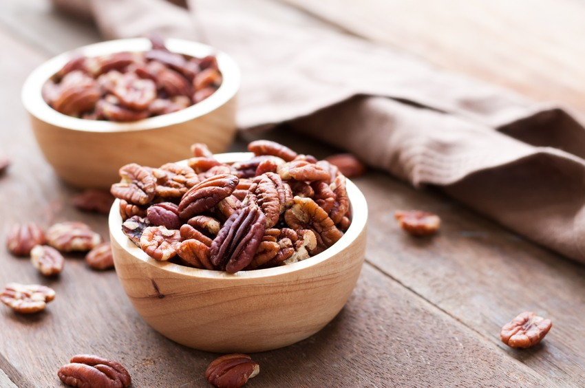 Pecan nuts on wooden bowel