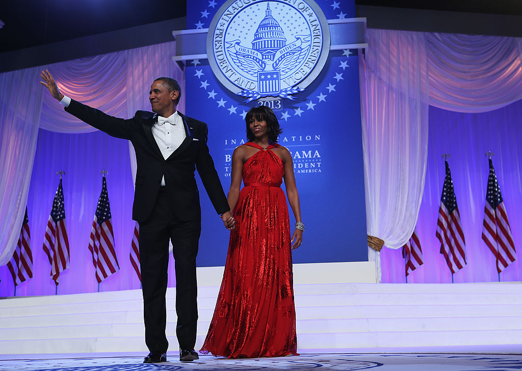 U.S. President Barack Obama and first lady Michelle Obama wave to the crowd