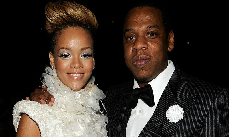 Rihanna and Jay Z pose together for a photo in formal wear