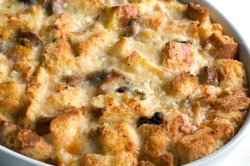 golden melted cheese and savory bread pudding